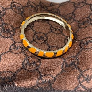 Orange hinged bracelet clamper style gold tone